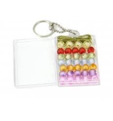 34 Pärlor med band i box med nyckelring