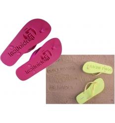 Flip flops with debossed logo